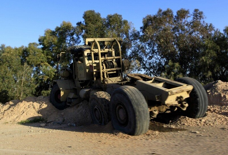 A damaged vehicle is seen in the city of Misrata