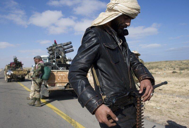 Rebel fighters wait near to advance near