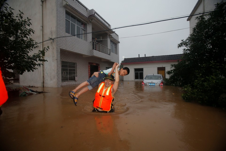 A rescuer saves a resident from a flooded area in Wuhan