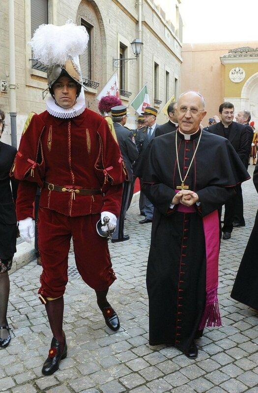 Swiss Guard Commandant Anrig walks with Archbishop Filoni at the Vatican