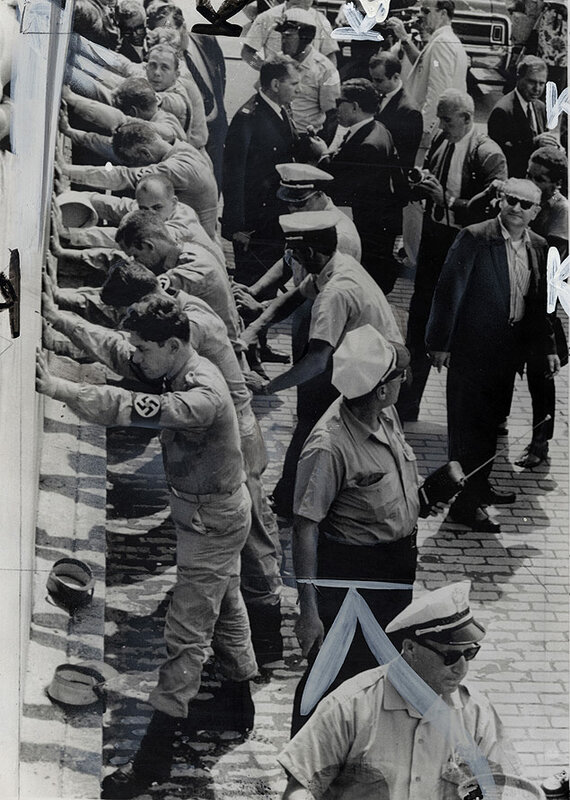 Members of the American Nazi Party are searched by police after a fight with an ex-Marine outside. Democratic Convention Hall in Atlantic City, N.J