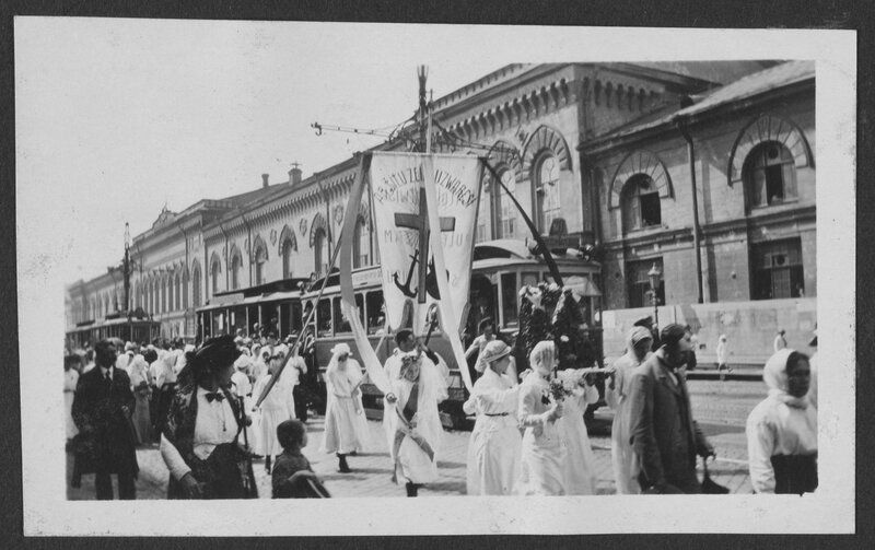 Women carrying a religious banner.