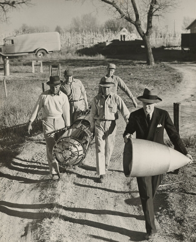 People transport an unsheathed rocket and cap in New Mexico, 1940 Photograph by B. Anthony Stewart, National Geographic