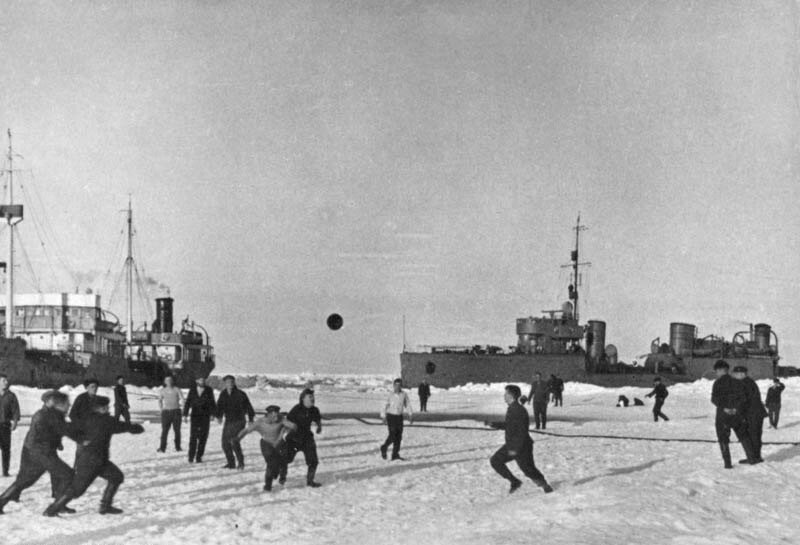 Members of EON-3 (Special Purpose Expedition 3) play football on the ice near the Vilkitsky Strait, 1936. On the right is team Stalin versus team Voikov on the left
