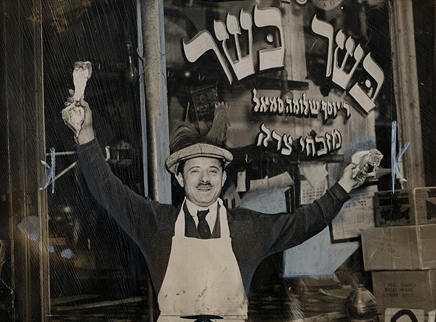 Butcher Sam Smoll welcomes the end of a day-long strike by about 5,000 butchers that protested the high cost of kosher meats and poultry 1937