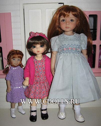 Кукла с зелеными глазами и рыжими волосами