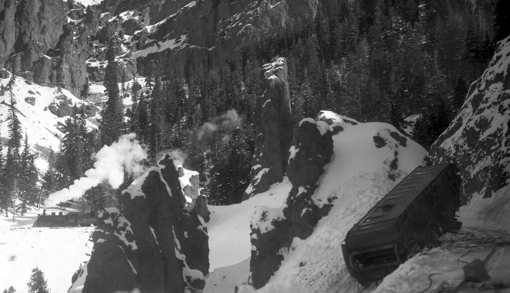 """D&RGW wreck. Wreck of the """"San Juan', 3 cars derailed by snowslide, parlor car """"Durango"""" on its side beside the track, near Toltec, N.M., February 15, 1948"""