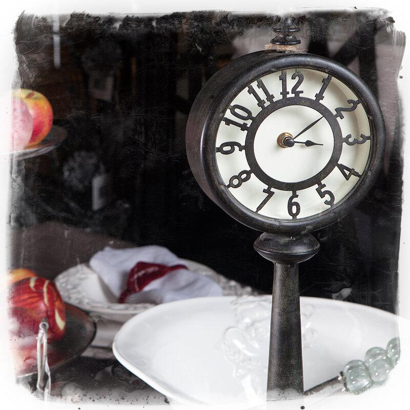 Portobello Road Market . London. old clock at the table
