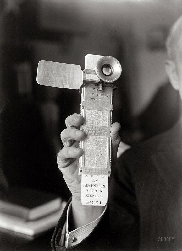 Circa 1922, the Fiske Reading Machine in the hand of its inventor, Rear Admiral Bradley Fiske
