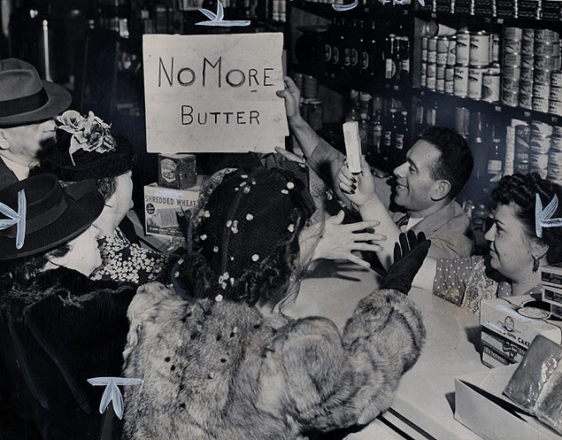 With war rationing in effect shoppers rush to snag the last quarter pound stick of butter at the Algonquin Delicatessen