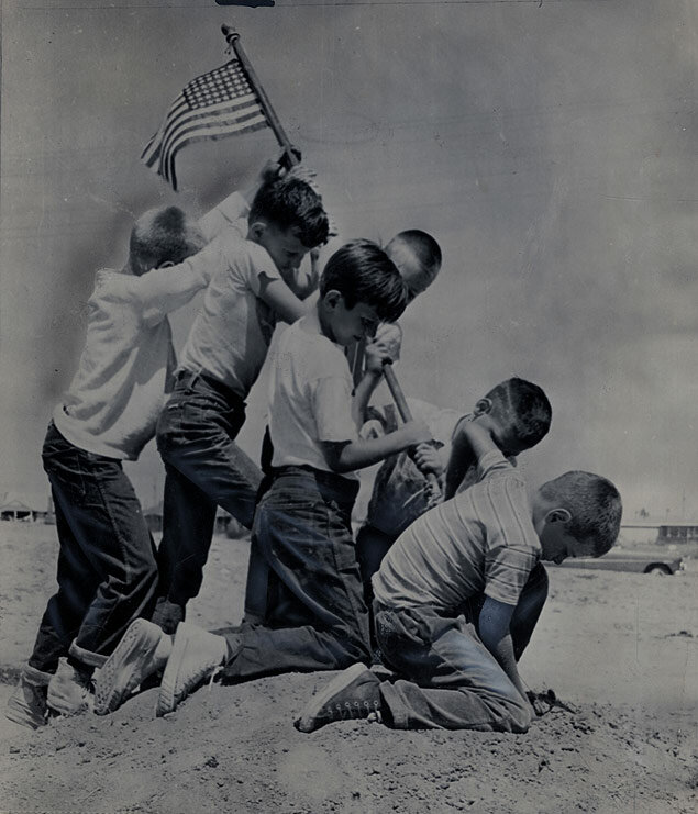 In honor of Flag Day, boys at Long Beach, California, mimic the famous photograph of the Marine Corps flag-raising on Mount Suribachi during the battle of Iwo Jima
