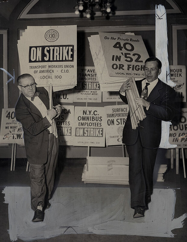 Members of the Transportation Union Workers prepare picket signs for the scheduled midnight strike on all city buses