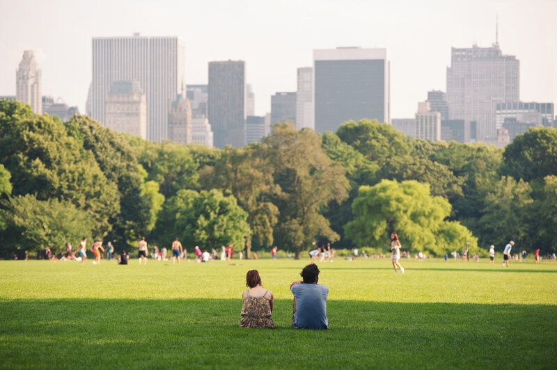 People enjoying relaxing outdoors in Central Park in New York.
