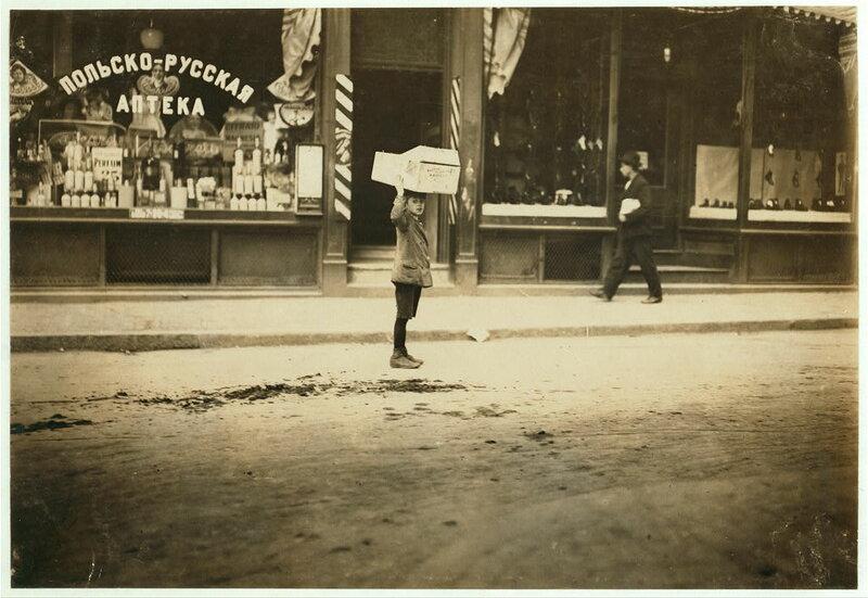 Carrying wood home. Location: Boston, Massachusetts