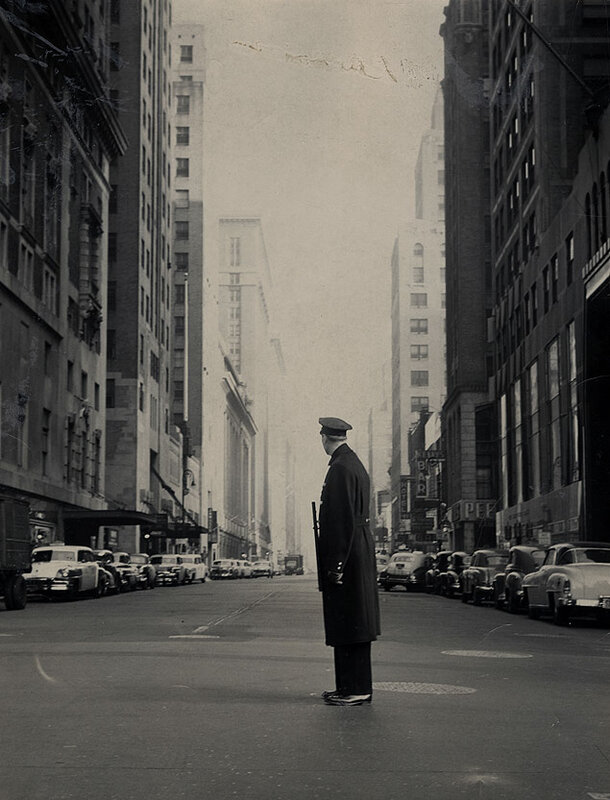 NYC patrolman Donald Schultz surveys the abandoned corner of 42nd Street and Lexington Avenue during the morning air raid drill in Manhattan