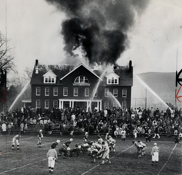 Spectators watch both the annual Mt. Hermon-Deerfield Academy football game and the science building fire at Mount Hermon School in Massachusette; the school lost both