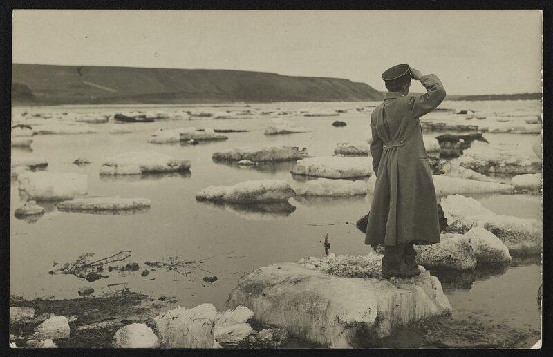 Soldier saluting on iceberg, Enisei River, Siberia.
