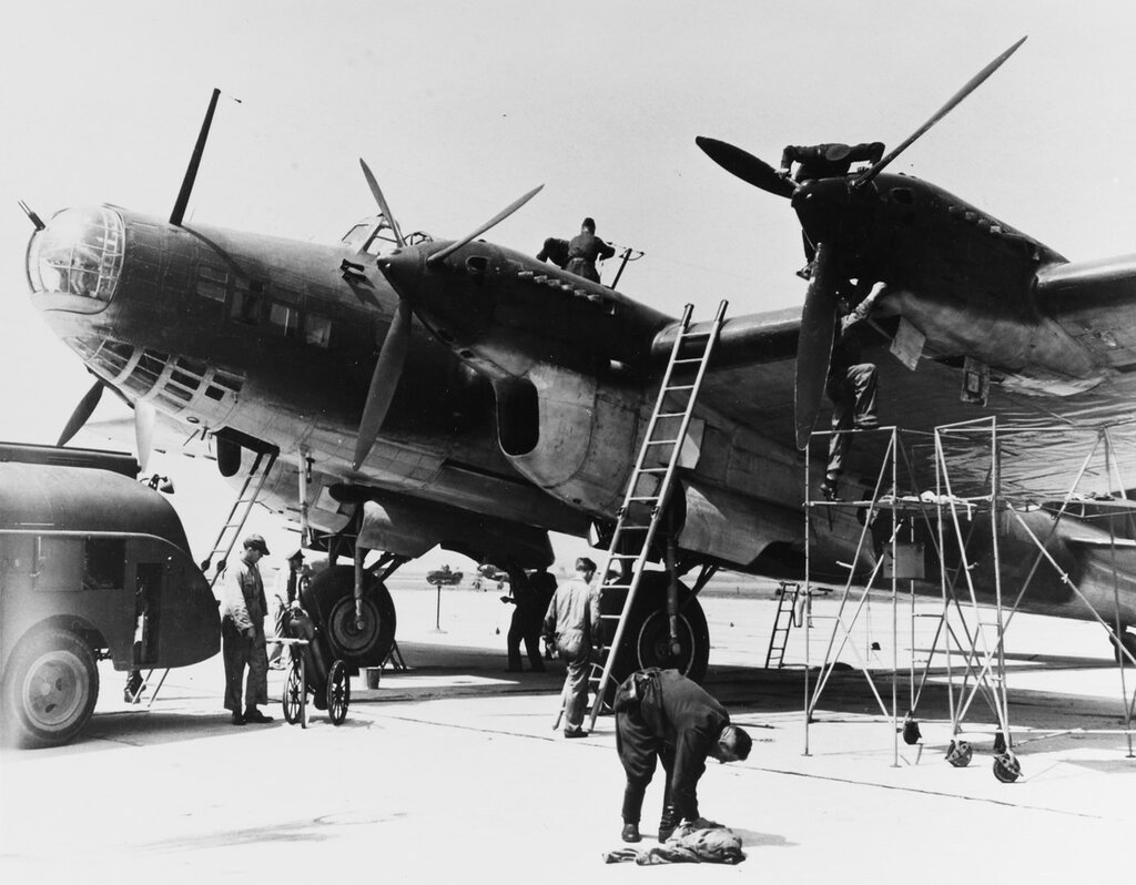 Petlyakov PE-8 (Soviet Heavy Bomber). Being serviced at Bolling Field, D.C., in 1942. It had brought Soviet foreign minister Molotov to the United States. Note Russian and USAAF personnel working on the plane.