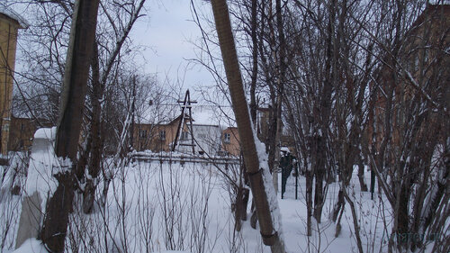 Фотография Инты №2844  Южная сторона домов Коммунистическая5 и 6 (в левой части кадра виден дом 20, правой - 22) 31.01.2013_13:35
