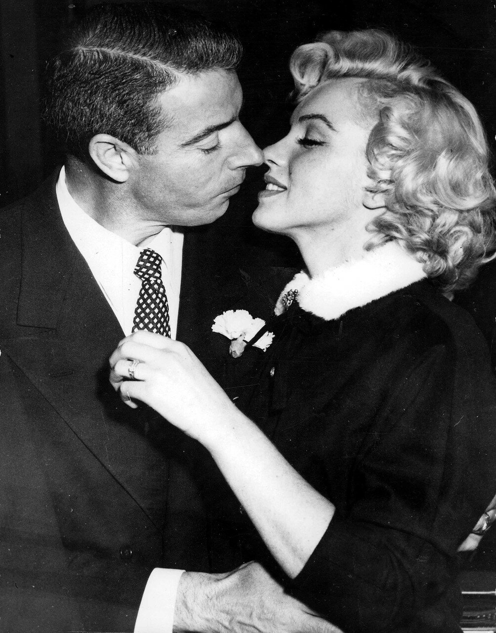 T,V, and Films, 16th January 1954, San Francisco, USA, Legendary Hollywood Film actress Marilyn Monroe prepares to kiss her husband former US Baseball player Joe DiMaggio after their wedding