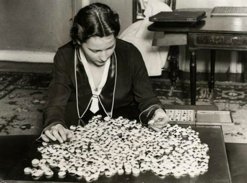 Molly Taylor sorts through a pile of eyes, London, 1933