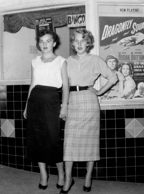 Two girls going to the movie, Brisbane Theater, San Mateo, CA, 1954