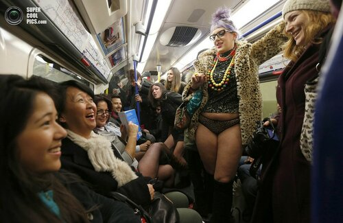 Passengers react to participants in the fourth annual 'No Trousers Tube Ride' on  the London Underground in London