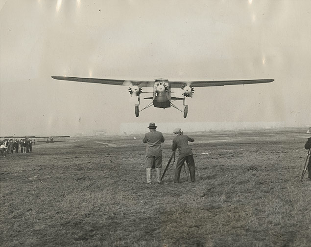 Photographers filming the Fokker F-10, a passenger- and mail-carrier and the largest plane ever built to date, during its final tests at Teterboro, New Jersey