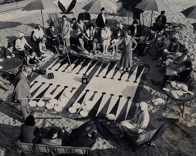 The revival of backgammon leads members of the Miramar Club in Santa Monica, California, to invent a beachside version of the game.jpg