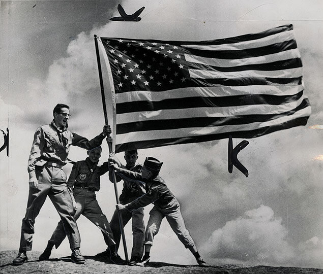 The new American flag with Hawaii's 50th star is unfurled by a Boy Scout patrol atop Mt. Marcy in the Adirondacks