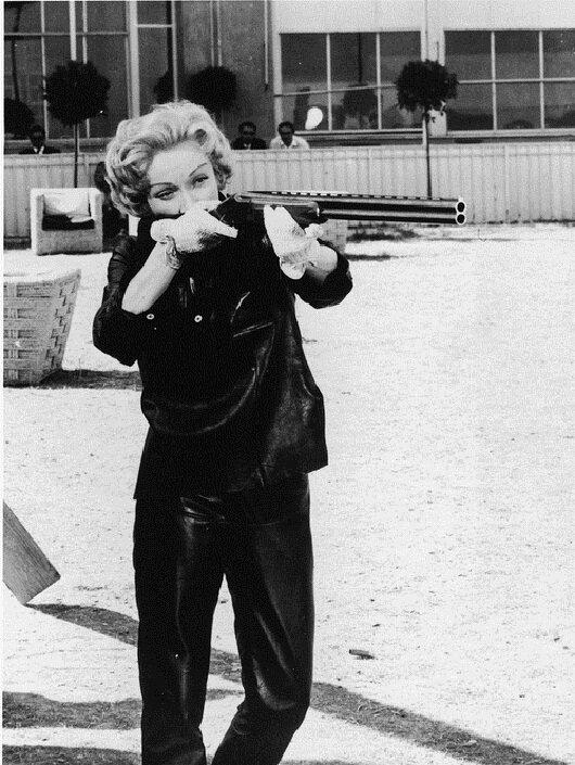 Dietrich Aims Her Gun