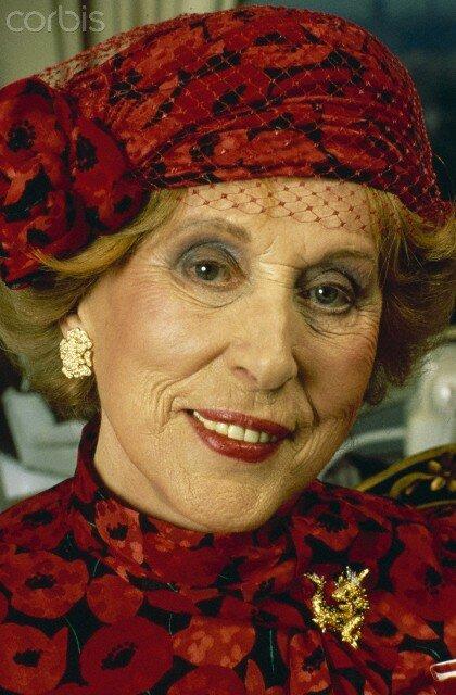 Estee Lauder in Red Floral Cap