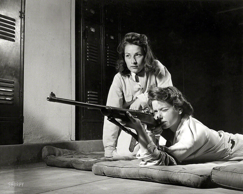 August 1942. Training in marksmanship helps girls at Roosevelt High School in Los Angeles develop into responsible women