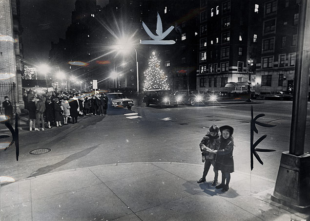 Two singers break off from the main groups of Christmas carolers who were stationed all along Park Avenue from 68th to 86th Streets.jpg