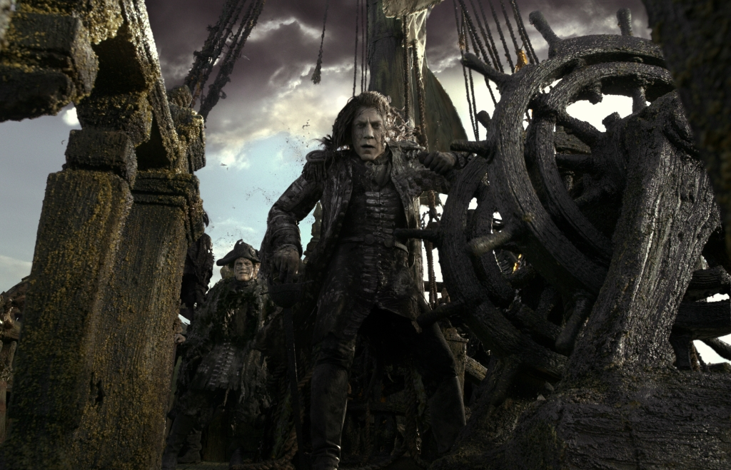 """PIRATES OF THE CARIBBEAN: DEAD MEN TELL NO TALES""The villainous Captain Salazar (Javier Bardem) pursues Jack Sparrow (Johnny Depp) as he searches for the trident used by Poseidon.Ph: Film Frame©Disney Enterprises, Inc. All Rights Reserved."