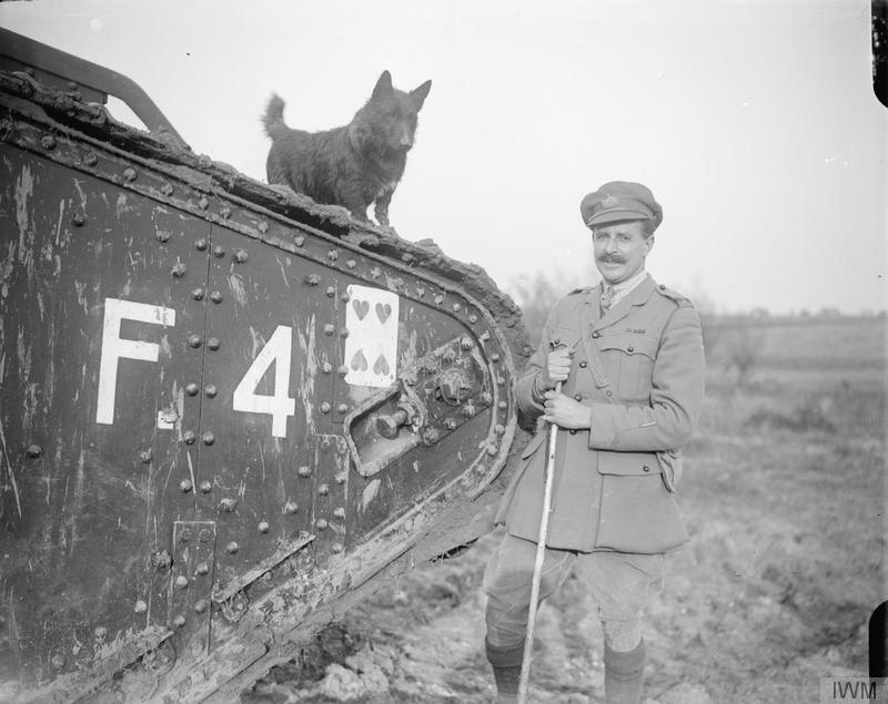 The commander of Tank F4 with the dog mascot of the tank at the Tank Driving School during the special training for the Battle of Cambrai at Wailly, 20 October 1917.