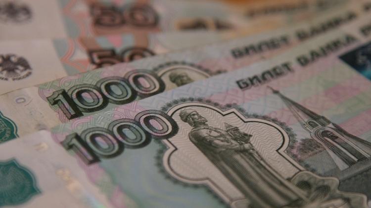 Банк РФ снизил курс доллара до59 руб.