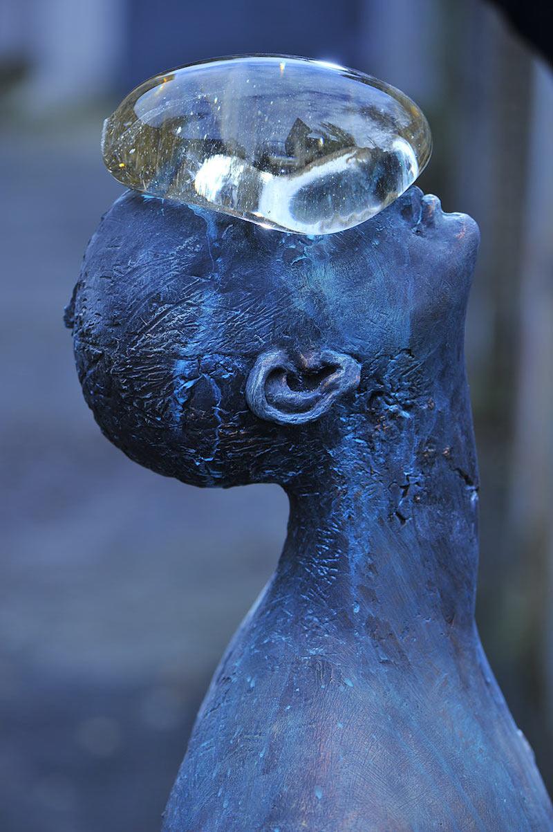 A Giant Glass Raindrop Balances on a Bronze Man's Face in Ukraine (8 pics)