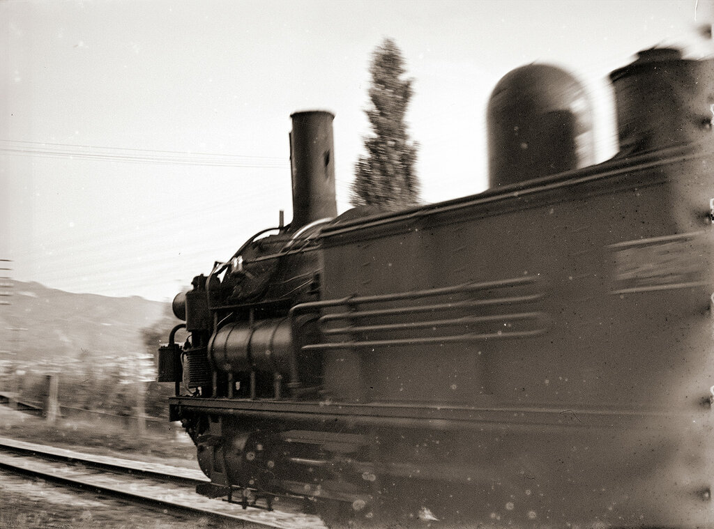 1930s Locomotive Moving Down Tracks in Japan.