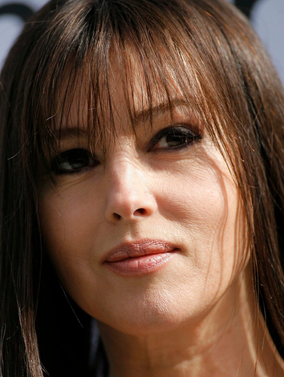 Actress Monica Bellucci poses during a photocall to promote her Madrid