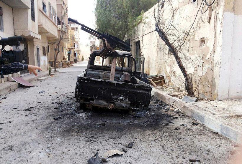 13. Солдаты сирийской армии на улицах древней Пальмиры, 27 марта 2016. (Фото SANA):