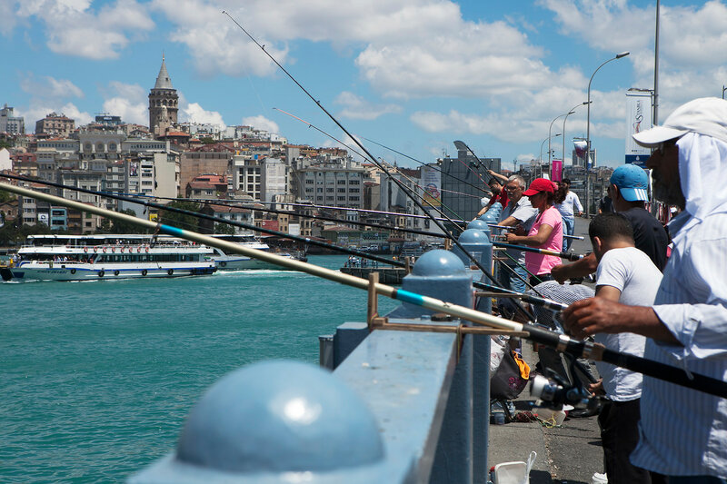 Men fishing from the Galata Bridge, Eminonu, Istanbul, Turkey