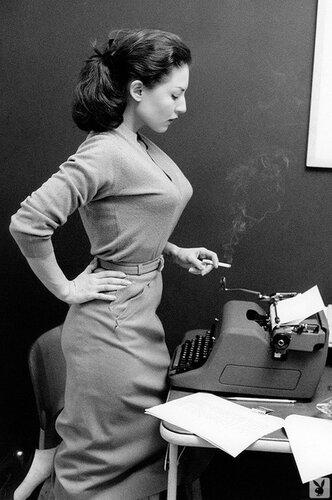 Opera singer Maria Callas writing and reading at a Royal Typewriter