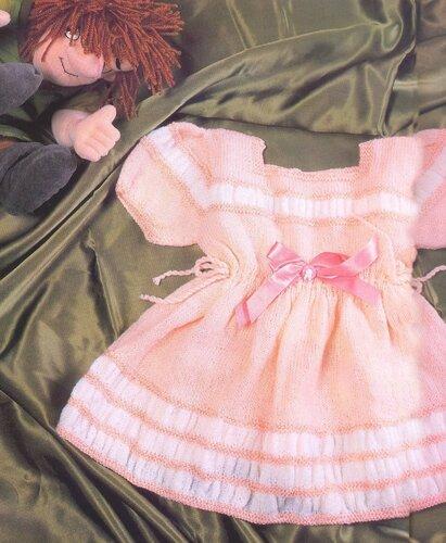 Розовое платье на девочку на 1-2 года, связанное спицами