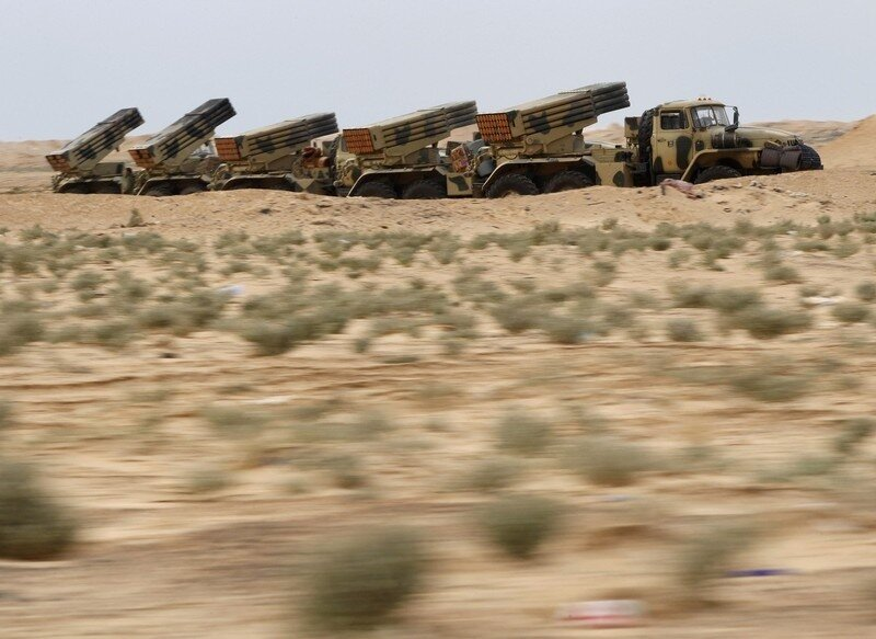 Libyan government army rocket launchers are seen in the desert near the west gate of town Ajdabiyah