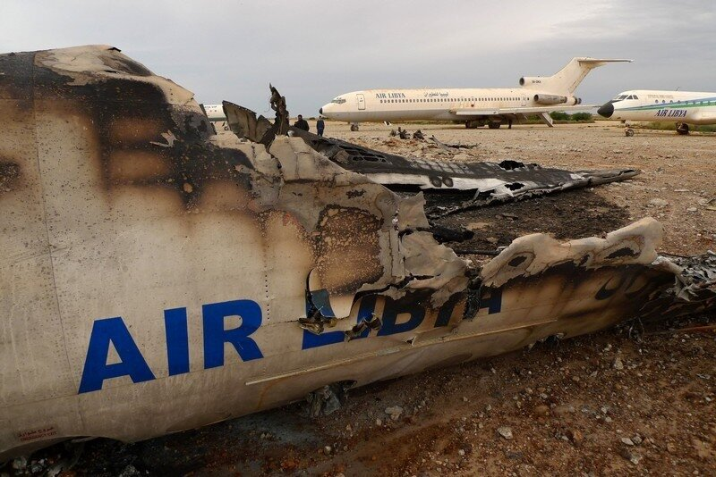 A wrecked Libyan commercial plane sits o