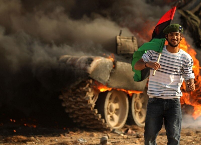A Libyan rebel holds the Kingdom of Liby