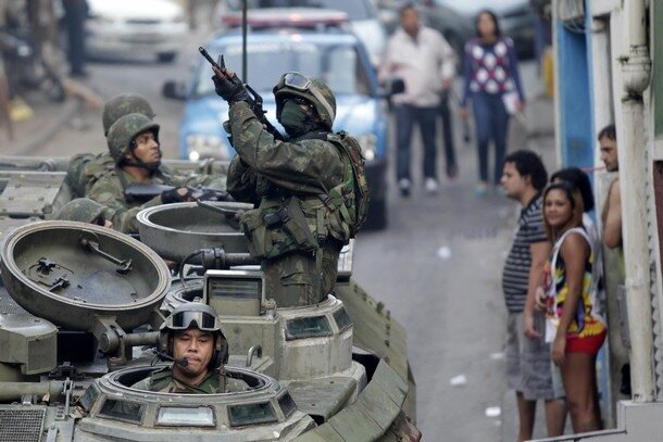 Brazilian Navy soldiers patrol in an armoured vehicle during an operation against drug dealers at Mangueira slum in Rio de Janeiro