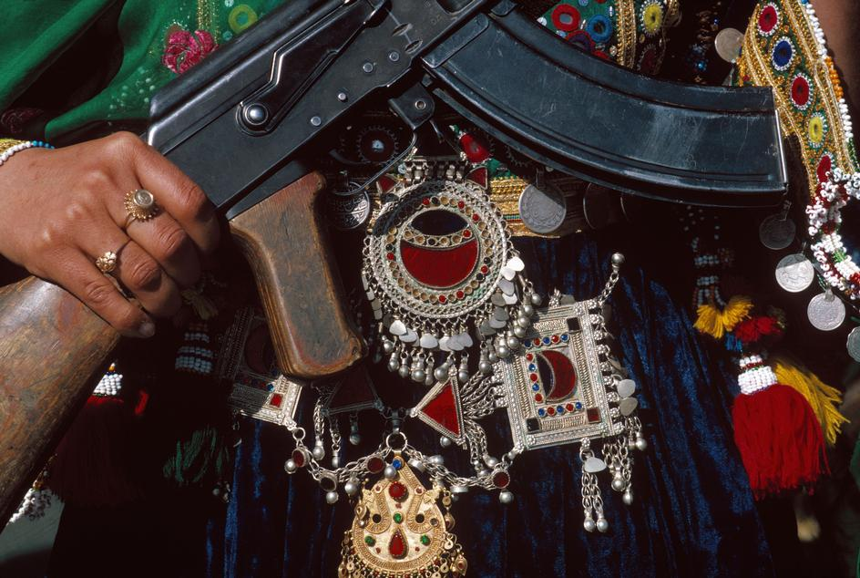 1986 Kabul. May 27 A Muslim woman in traditional clothes and jewellery celebrates the anniversary of the Coup d'Etat of 1978.jpg