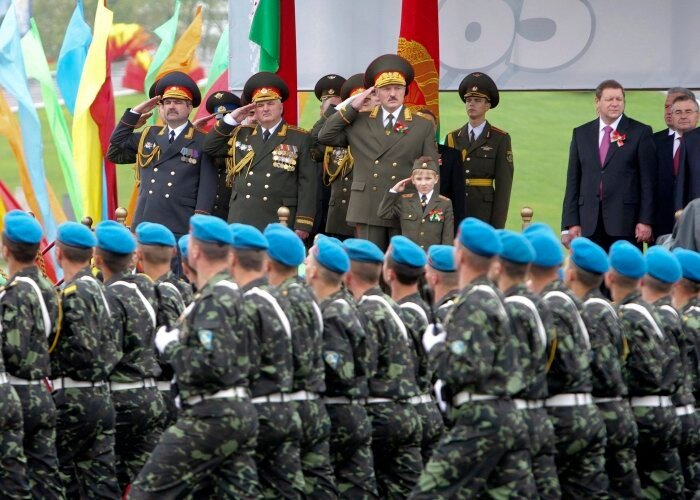 Belarussian President Lukashenko reviews a military parade in Minsk